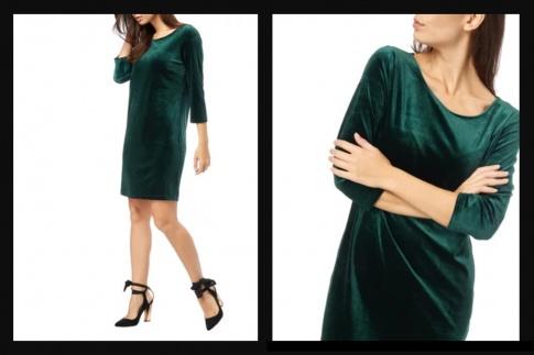Eine Frau trägt ein dunkelgrünes Samtkleid