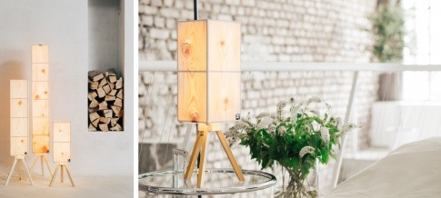 Eine Zirbenholz Lampe steht in einem Schlafzimmer