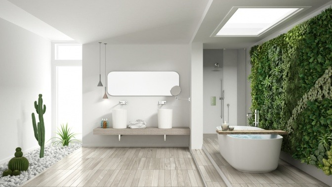In einem Badezimmer sind Holz, Pflanzen und Steine