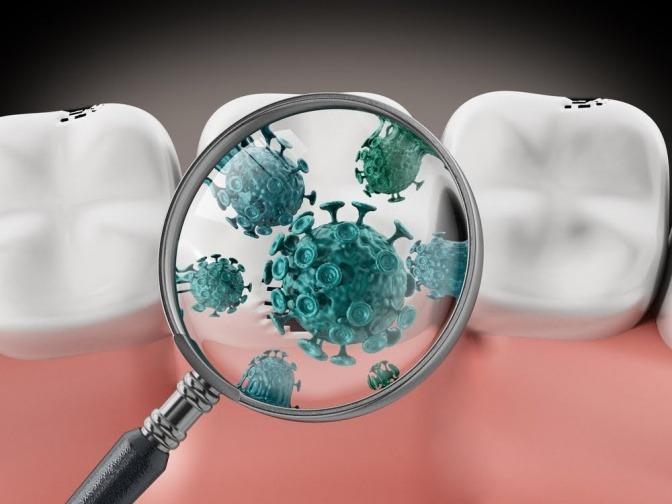 Auf einer Grafik zeigt eine Lupe Bakterien im Mund