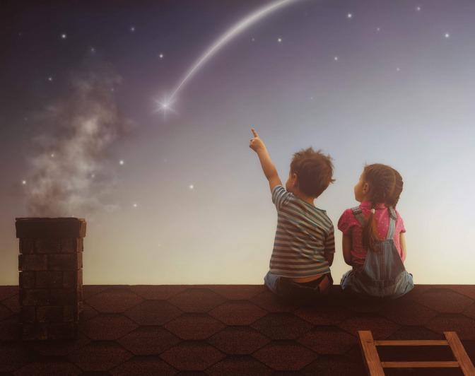 Kinder auf dem Dach beobachten Sternschnuppen.