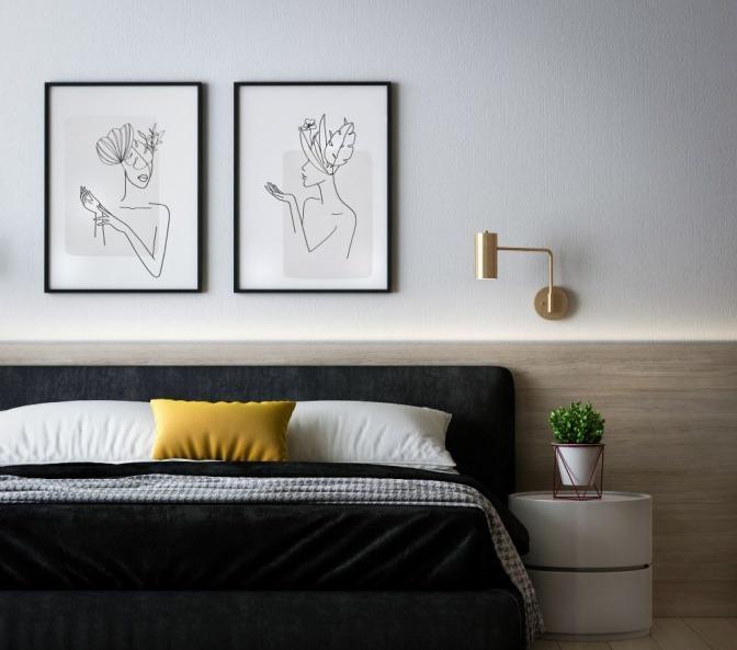 Ein Schlafzimmer ist modern eingerichtet