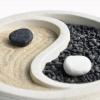 Ein Yin-Yang Symbol wird mit Sand und Steine dargestellt